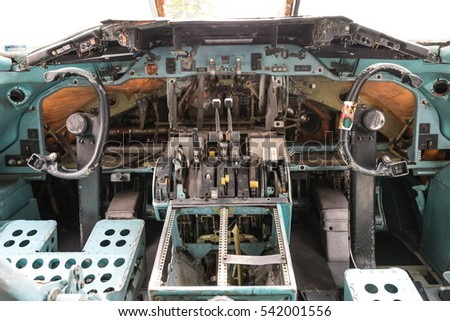 Inside airplane wreckage cockpit, taken on a sunny day, useful for plane safety, pilot, flights, air craft, aero space industry, travel, holiday, insurance related concepts
