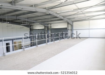 inside an industrial warehouse with metallic beams