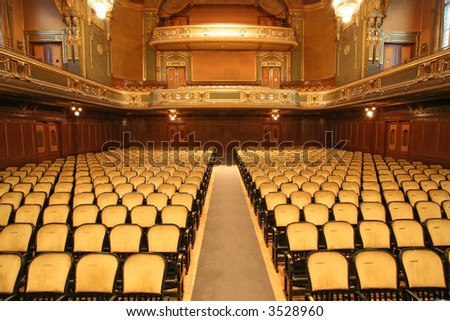 inside an old auditorium, gold and velvet decoration - stock photo