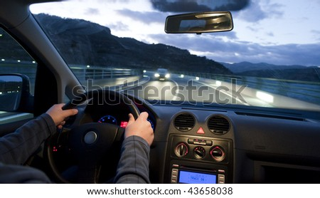 Inside car view at two ways road - stock photo