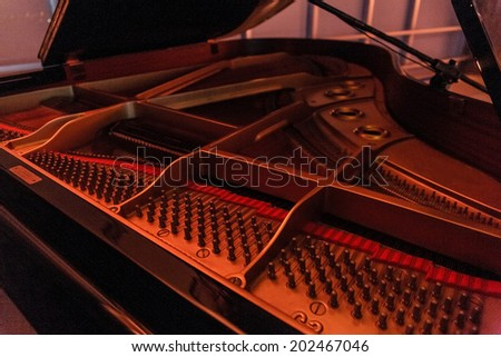 inside of a piano with the strings in sight - stock photo