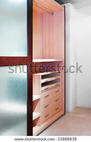 Inside of an empty wardrobe with shelves