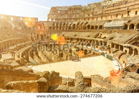 Inside of Colosseum (Coliseum) in Rome, Italy. The Colosseum is an important monument of antiquity and is one of the main tourist attractions of Rome. - stock photo