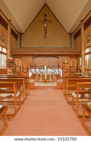 Inside of small catholic wood church in Thailand