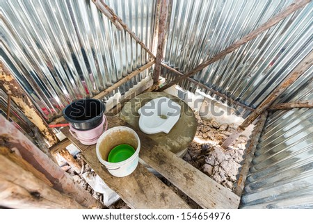 Inside of temporary toilet at construction site - stock photo