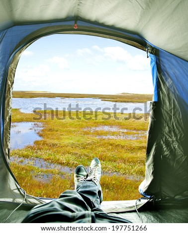 Inside of tent with view on lake - stock photo