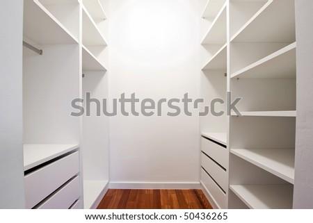 Inside of the empty white walk-in wardrobe - stock photo