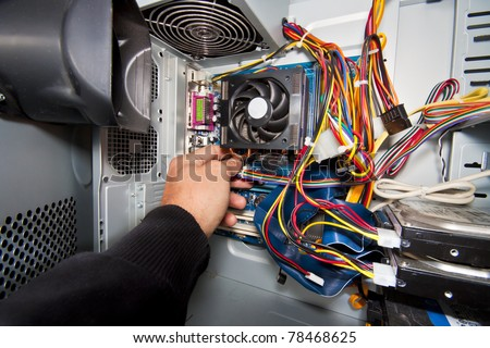 Inside of the personal computer (power supply motherboard, cables, discs, fan...) - stock photo