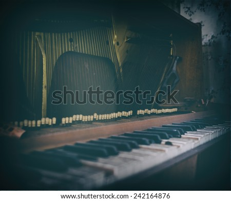 Inside old vintage opened piano bordered - stock photo
