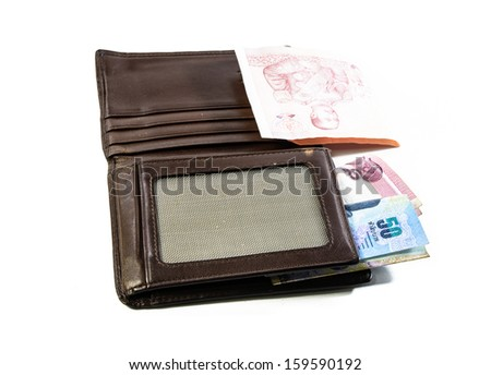 inside single general brown wallet and thailand money isolated on white backgrounds