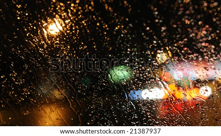 Inside the car - night rain and town lights background