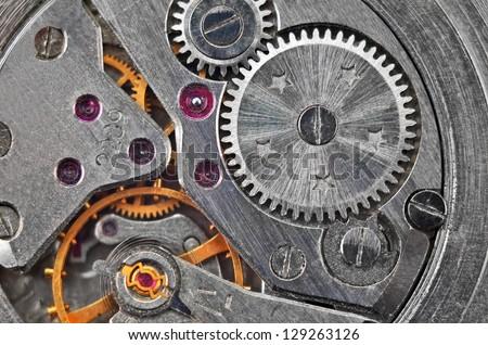 Inside the clock (watchwork), antique vintage clock mechanism - stock photo