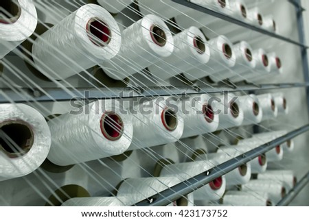Inside the cotton mill, a factory housing powered spinning or weaving machinery for the production of yarn or cloth from cotton - stock photo