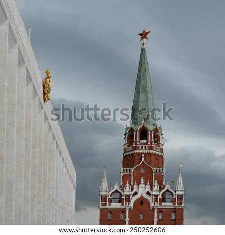 Inside the Kremlin, Moscow - The State Kremlin Palace and Trinity Gate Tower entrance - stock photo