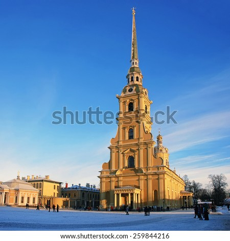 Inside the original citadel Peter and Paul fortress around the Cathedral with sunny weather. Saint Petersburg, Russia. Main touristic attraction in the city, people walking around - stock photo