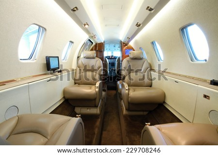 Inside the rear part of the business aircraft cabin - stock photo