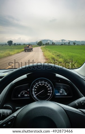 Inside vehicle steering wheel with countryside road