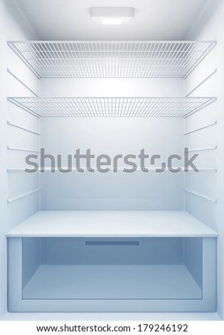 Inside view of an empty Modern Fridge with Blue Light - stock photo