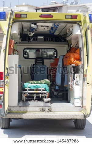 Inside view of used ambulance. Photo taken from the rear doors. - stock photo