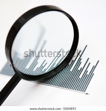 Inspecting the figures (closely!) - shallow dof - stock photo