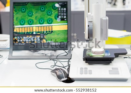 Inspection electronic circuit board by automate vision system show result on monitor in lab room