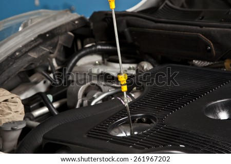 Inspection of the engine oil - stock photo
