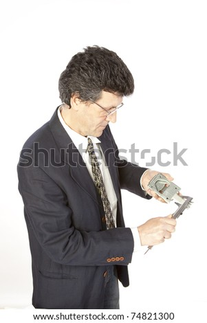 Inspector/engineer checking metal components. - stock photo
