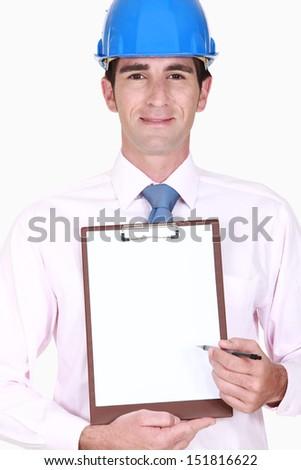 Inspector holding clip-board - stock photo