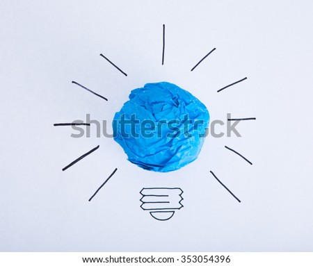 Inspiration concept crumpled color paper light bulb metaphor for good idea. - stock photo