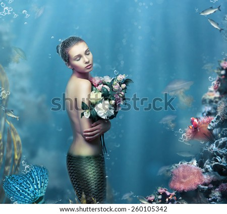 Inspiration. Fantastic Woman with Flowers in Water - stock photo