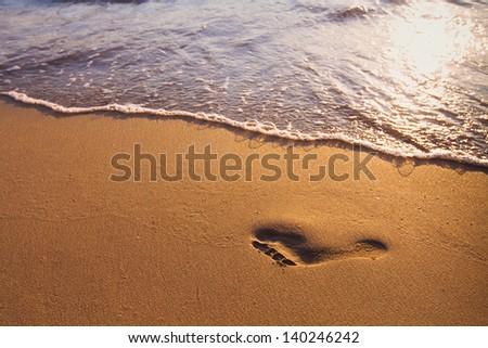inspiration, footprint on the beach - stock photo