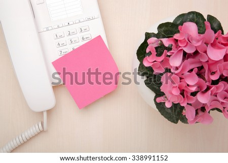 Inspiration top view of blank sticky note on phone with flower - stock photo