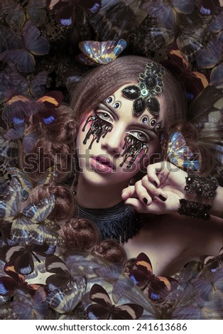Inspiration. Woman with Fantastic Teardrops and Butterflies - stock photo