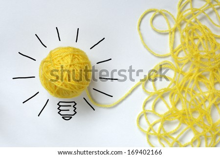 Inspiration wool light bulb metaphor for good idea - stock photo
