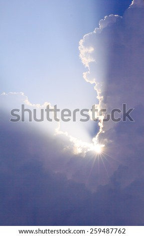 Inspirational cloudscape backlit by sun - stock photo