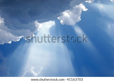 Inspirational light shining through clouds