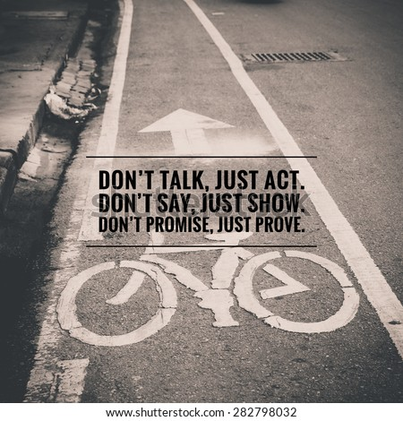Inspirational quote by unknown source on vintage black and white street with bicycle lane sign background - stock photo