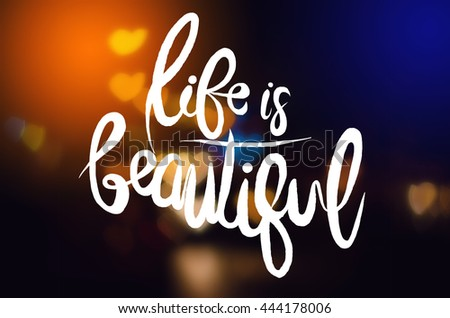 Inspirational Quote .life is beautiful.Multicolour bokeh Heart shape ,defocused bokeh lights as background - stock photo