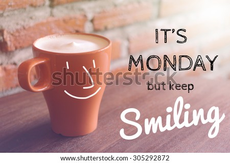 Inspirational quote on blurred coffee cup background with vintage filter - stock photo
