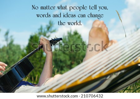 Inspirational quote on life by the late, great, Robin Williams, with a songwriter working on this art while relaxing in his hammock in the summer. - stock photo