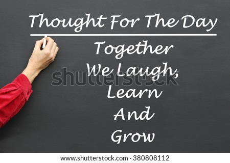 Inspirational Thought For The Day message of Together We Laugh, Learn And Grow written on a School Blackboard by the teacher. - stock photo