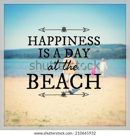Inspirational Typographic Quote - Happiness is a day at the beach - stock photo