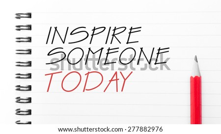 Inspire Someone Today Text written on notebook page, red pencil on the right. Motivational Concept image