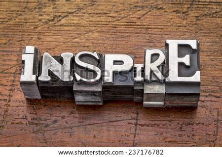 inspire word in mixed vintage metal type printing blocks over grunge wood - stock photo