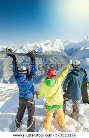 Inspired group of snowboarders at summit. Winter sports. Switzerland, alps. Snowboard. Healthy lifestyle and outdoor activity