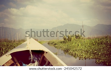 Instagram filter look from a canoe on a river in a gorgeous landscape in the shan state of Myanmar .  - stock photo