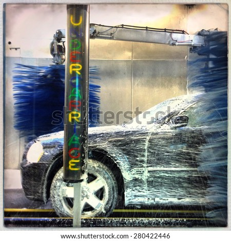 Instagram filtered image of a car in a car wash - stock photo