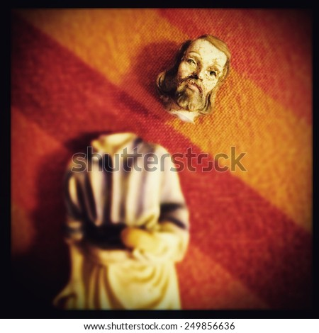 Instagram filtered image of broken Saint Joseph statue  - stock photo