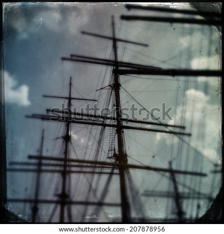 Instagram filtered image of sailing ship masts - pirate ship - stock photo