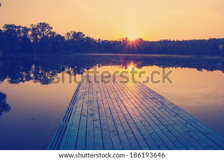 instagram nashville tone orange sunset sunrise lake boat and trees - stock photo